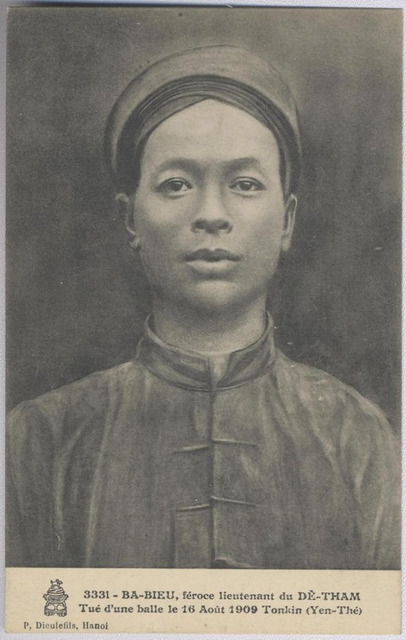 "Figure 4: series number 3331, BA-BIEU, féroce lieutenant du DÊ-THAM Tué d'un balle le 16 Août 1909 Tonkin (Yen Thé), (""BA-BIEU, ferocious lieutenant of  DÊ-THAM, killed by a bullet on the 16th of August, 1909, Tonkin (Yen-Thé)""), image attributable to Captain Péri, postcard published by Pierre Dieulefils, Hanoi,  ca. 1909, addressed to a married woman in France, message dated the 23rd (month illegible), 1918 (no postmark)."