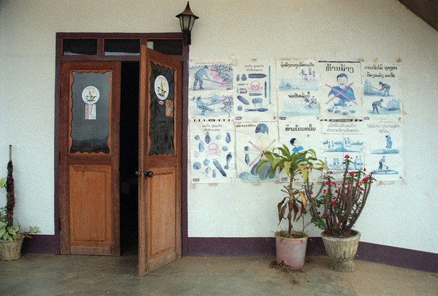 Fig. 1.1: Guest house in Phonsavan displaying MAG posters in 2000.