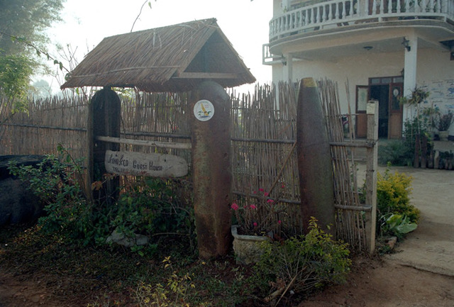 Fig. 2.8: Guest house sign supported by bomb casings in Phonsavan, Laos.