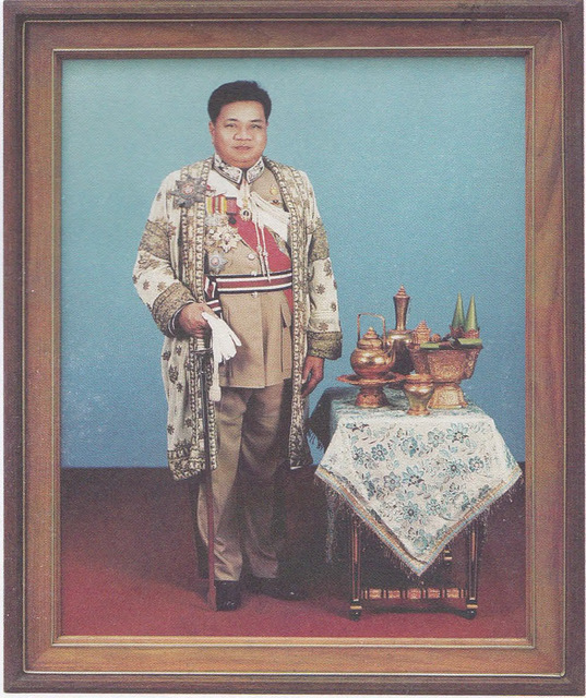 Fig. 11: Chaya Jittakorn studio, Photograph of a Thai Civil Servant in Uniform, with Royal Betel-nut Set and Royal Robe for Service to the King, c. 198.