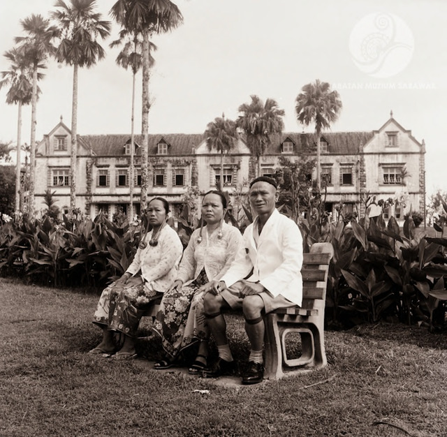 Figure 1:Penthulu Gau, his wife A'an Kuleh and his sister in law from Long Ikang on the Baram river, seated in front of the Sarawak Museum, Kuching, 1956. Photograph from the archive of the Sarawak Museum.