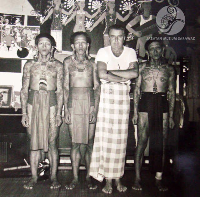 Figure 3: Tom Harrisson and three Penan men at Harrisson's home at the Bungalow Segu, Kuching, date unknown. Photograph from the archive of the Sarawak Museum.