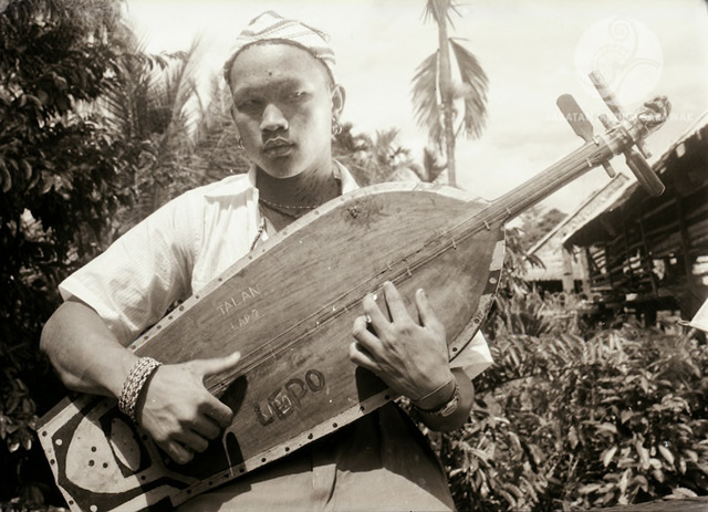 Figure 13: Lepo Kukum playing a sape, Long Jegan, 1956. Photograph from the archive of the Sarawak Museum.