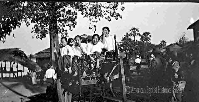 Four girls from the American Baptist Mission Karen Mission School in Daingwunkwin, Moulmein [Mon State], leaving Pa-an [Karen State] for a 20-mile bullock cart ride to Mowko [village]. February 3, 1922.