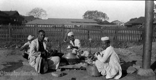 Portable wayside tea shop, on Pagoda Road, Rangoon. Dormitories of University College are seen in the background. January 1, 1925.