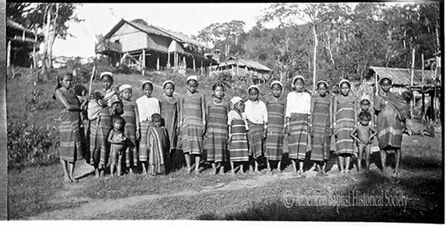 Sainbaung Chin women and children in native garb, at Ainbu Ywathit (the new Ainbu village), in Kyaukphyu District [Arakan State]. Note the carrying slings for infants. December 24, 1935.