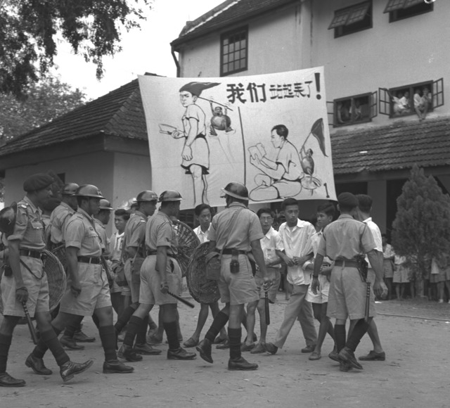 Fig. 6. Police and students at Chung Cheng High School during the student riots in 1956. (Singapore Press Holdings, courtesy of National Archives of Singapore)