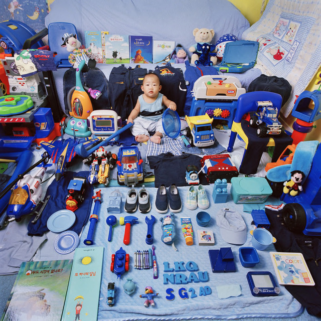 "Jeongmee Yoon, ""Yeachan and His Blue Things,"" The Pink and Blue Project, 2005, light jet Print, courtesy the artist."