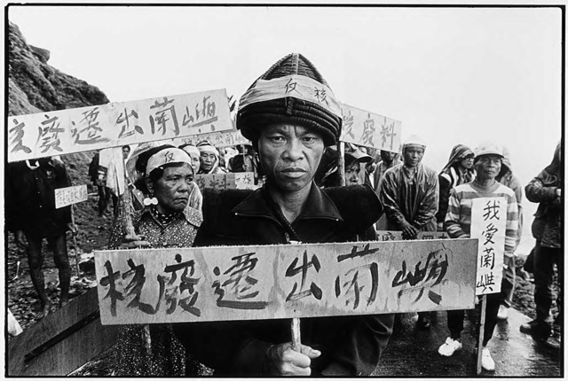 "Guan Xiao-rong, Local demonstrators hold signposts that say ""Nuclear waste out of Lanyu"", © Guan Xiao-rong, courtesy the artist."