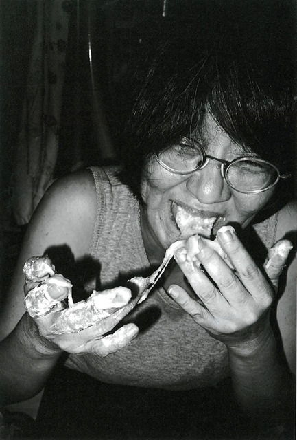 "Fig. 3. Yamamoto, Masaki, ""My mother licking her hands stuck with sticky rice as she couldn't make the rice-cakes properly."" (From Guts, 2017.)"