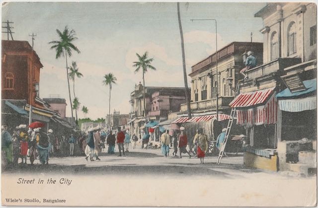 Fig. 34. Street in the City, published by Wiele's Studio, Bangalore. From the private collection of Dr Emily Stevenson.