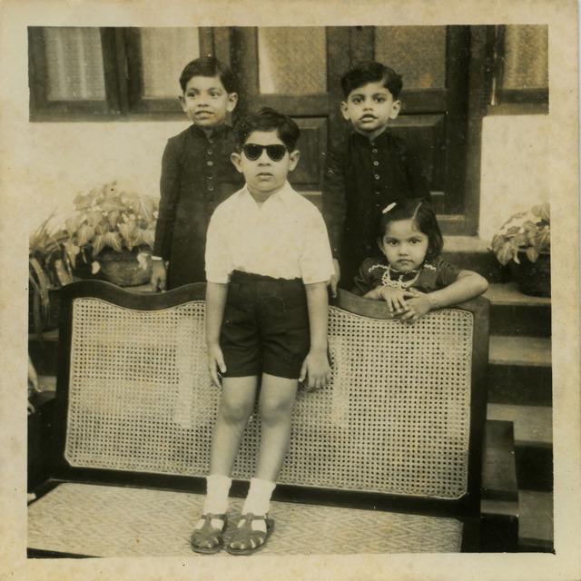 Fig. 17. Haleema Hashim, Anwar Hashim, Arif Hashim, Yasmin Ismail and, on bench, Rafeeq Ismail, 1950s, 6.35 x 6.35 cm., courtesy of Nihaal Faizal.