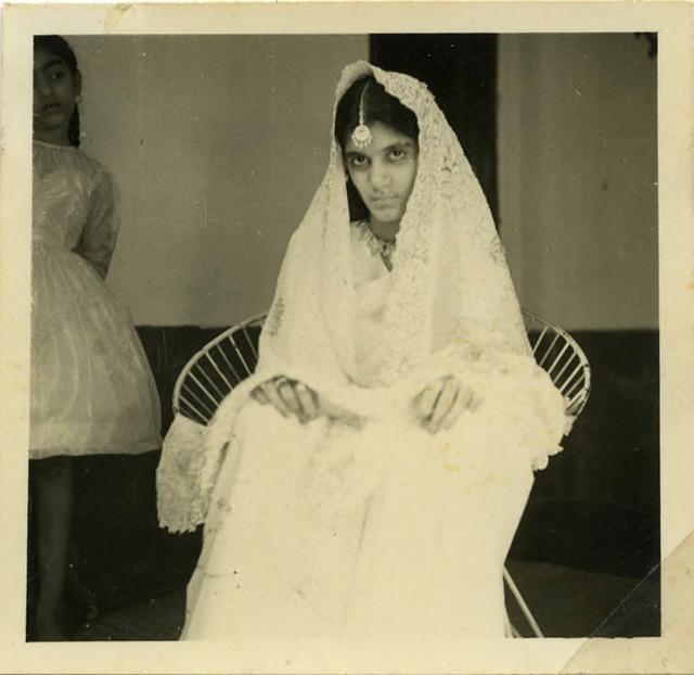 Fig. 44. Haleema Hashim, Saira Suleiman, with Firdaus Aslam in the background, 1960, 6.35 x 6.35 cm., courtesy of Nihaal Faizal.