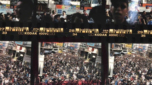 Fig. 2. Wei Leng Tay, Article 23 protest, Causeway Bay, 1/7/2003. Contact sheet, Kodak 400VC negative, 35mm, 2019. Archival pigment print, 28.125x50cm, edition of 5, © Wei Leng Tay, courtesy the artist.