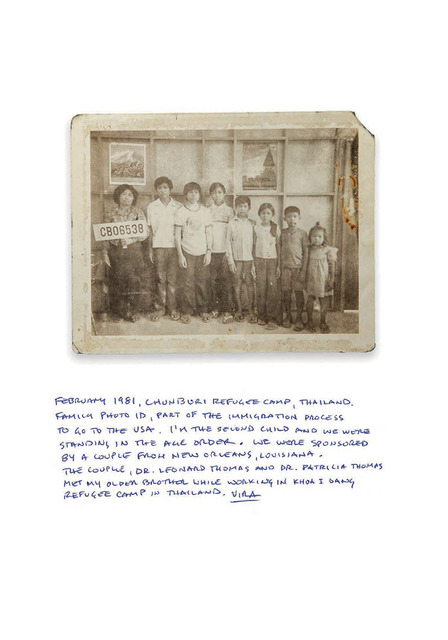 "Fig. 10.  Dimensions: 3.4 x 4.2 inches, Early 1981. This was taken at Panasnikhom Chonburi Transit Centre (Thailand), this would have been made at the same time that we made the individual portrait, we had this group shot made first. When I look at it now I wonder why they chose this as the background and why they put the posters on the back? Were they trying to make the images a bit nicer? The staff were Thai workers who made the images and did the administration. In this camp we had no fear of the ""Angkar"" (Khmer Rouge) but in the border camps all the international staff left at night. We worried about attacks from across the border by the Khmer Rouge. When we first moved to the camp, there were just a few minor incidents caused by Khmer Rouge people. We heard there was a handful of Khmer Rouge in Khao-I-Dang. They didn't feel safe there, so they eventually left the camp and moved to camp."