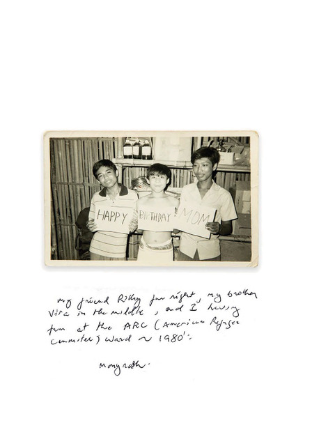 Fig. 12.  Dimensions: 3.5 x 5.5 inches, Late 1980. The photograph was taken by one of the nurses at the Khao-I-Dang Holding Centre, she was from the USA. She wanted to make a picture to send home for her Mum for her birthday. I was in the middle (still wearing a towel from just having a shower). The photograph was made in the medical supply room, at the time I thought it was fun - I still look at it as fun. My brother, Monyroth, was working at the camp hospital; this is where we met our sponsors. These strangers had a massive impact on our destiny, I find it hard to put myself in their shoes, could I sponsor an entire family? They maybe saw something in us, but I don't know. With all this killing and brutality, still there are people with good heart and humanity. What makes strangers reach out to help other people in desperate needs, it is their genuine compassion and want to make a better world.