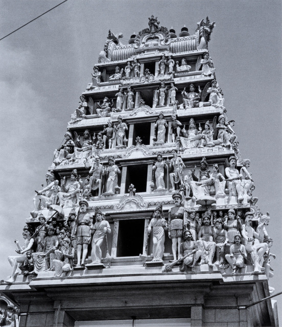 Fig. 4. Bright light etches the richly decorated gopuram above the Sri Mariamman Temple, Singapore's oldest Hindu temple. Marjorie Doggett, © National Archives of Singapore.