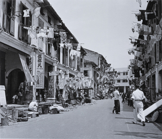 Fig. 6. Despite Chinatown's ramshackle environs, this 1952 photo suggests the life and interest that outsiders saw in the area. Marjorie Doggett, © National Archives of Singapore.